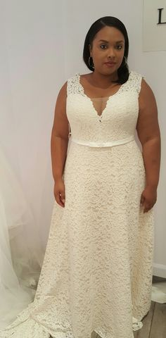 Plus size romantic lace A line wedding dress with interior corset and detachable long sleeves. Seline. Studio Levana