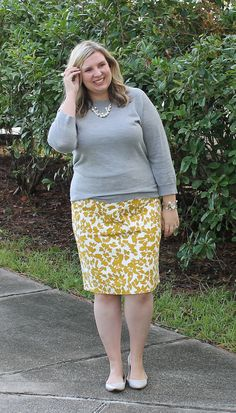 Cute work outfit: gray sweater paired with a mustard floral pencil skirt and gray pointed toe flats.