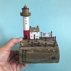 Washing day at the lighthouse. #shabbydaisies #shabbychic #lighthouse #nautical #driftwoodart #driftwoodart #rusticart #washingline #cottage #coast #sea