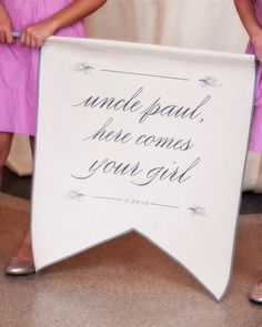 """Instead of flowers, Paul's J.Crew-clad nieces carried a linen sign that read, """"Uncle Paul, Here Comes your Girl"""" into the ceremony."""