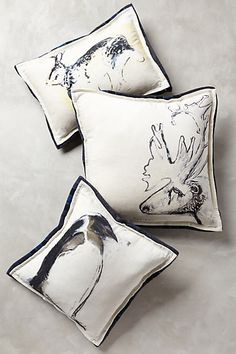 Northwood Pillow - anthropologie.com.  I like the whimsy.  The penguin and the hare are sold out, the two I would pick.  But we can keep an eye out for another option.