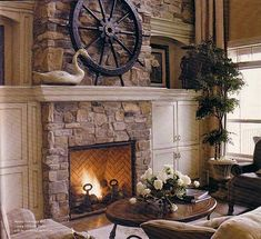 Stone fireplace mantle....I like the brick inside and stone outside
