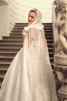 Tatiana Kaplun Bridal Collection 2015 | Lace Bridal Ball Gown Featuring A Strapless Straight Across Neckline With Thin Tulle Ruffle, Corset Style Bodice, Full, Lace Ball Gown Skirt; Shown With Coordinating Lace Hooded Cape..............................