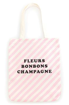 Carrying all the essentials in très-chic style using this pretty pink striped tote.