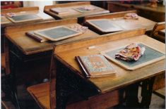 school desks - ours had holes at the top were the ink wells used to be, fortunately we'd moved on the ballpoint pens!