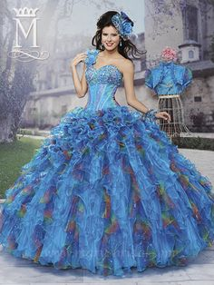 Organza, one-shoulder sweetheart Quinceañera ball gown with lace-up back, corset bodice embellished with beads and sequin, multi-toned ruffled skirt, and matching short pouf sleeve bolero.