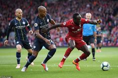 5a2aa9b3870 Fernandinho chases Mane (right) for the ball as David Silva (left) watches