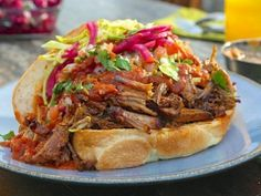 Guy Fieri's Tortas Ahogadas - a pork sandwich drenched in a spicy tomato sauce