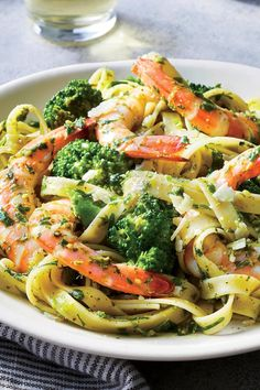 "Pesto Shrimp and Broccoli Fettuccine | ""Put your knife away—store-bought pesto and precut broccoli florets mean no chopping required. Your Dutch oven pulls triple duty in this recipe by cooking the pasta, blanching the broccoli, and bringing the whole dish together, all in one pot."" #pasta #pastarecipes #pastainspiration #pastadinner #pastaideas #pastadinner #pastaideas"