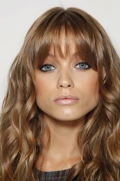 abbey lee with honey locks and bronzed face
