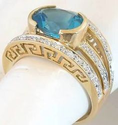 Oval Blue Topaz Wide Band Ring
