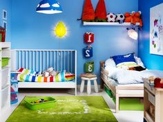http://keepmihome.com/wp-content/uploads/2015/04/Colorful-decoration-for-children-room-with-a-wooden-bed-and-a-baby-cot-801x601.jpg