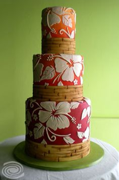 Fabulous for a Luau party! Love this Aloha print Wedding cake with bamboo trim~