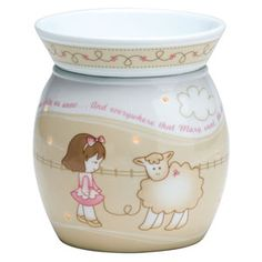 """Little Lamb Mid-Size Scentsy Warmer PREMIUM    Little Lamb features an embossed, pink and tan design on a porcelain base """"as white as snow."""" Encircled with lines from the classic nursery rhyme """"Mary Had a Little Lamb,"""" this warmer radiates sweetness."""