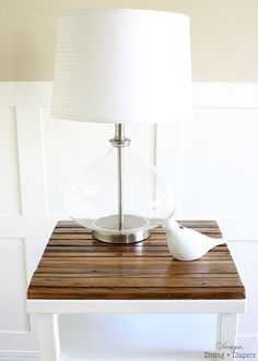 a little paint and some reclaimed wood turn a plain 'ol stained side table into something much better