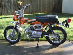 Honda Dax ST90 Mighty Dax my cousin used to have one of these when I was younger we would go rideing out at the lake during the summer I would take my XR 80 Honda and he would take his ST 90 Honda and drive all around that lake and have a blast miss those days