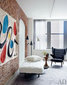 A shearling-covered daybed rests below an Alexander Calder-inspired weaving in the sitting area of Will Ferrell's Manhattan bedroom