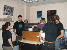 Undergraduate student Brian Dingee gives a demonstration of the cloud chamber. Credit: Bob Cook.