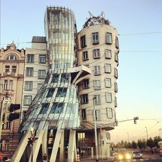 "The famous Nationale-Nederlanden building, nicknamed Dancing House (Tančící dům) or ""Fred and Ginger"".  It sits in the middle of a densely built section of Prague, surrounded by other structures that are nearly all the city's standard Baroque or Art Nouveau styles. It was designed by Croatian-Czech architect Vlado Milunić and Canadian-American architect Frank Gehry on a vacant riverfront plot"