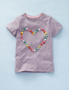 must try a t-shirt refashion of this Mini Boden t-shirt - pom poms sewed to a t-shirt - sarah will LOVE