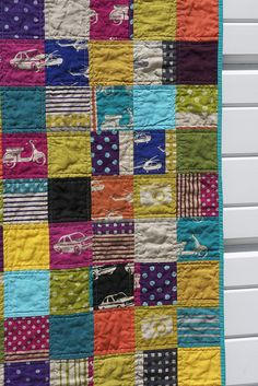 hipster baby quilt.  i need to learn how to quilt