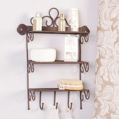 Making use of wall space whilst being effortlessly stylish this very storage wall shelf is ideal for a bathroom, hallway or kitchen. This shelf is made from cast iron and features three shelves along with 3 coat hooks making this unit essential for those rooms where floor space may be limited. This traditional vintage inspired wall mounted shelving unit is finished in dark antique brown colour making it perfect for all interior decors. Home Storage