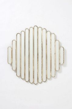 And this one! Thinking of changing up the art above the black unit..   Abate Slatted Mirror #anthropologie