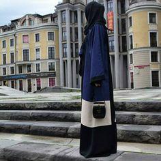 Fluid abaya worn by muslim sister in Russia www.annahariri.com