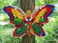Colorful Children's Art Enlivens the Shake Rag Grounds Bottle Top Art, Bottle Top Crafts, Bottle Cap Projects, Plastic Bottle Tops, Plastic Bottle Crafts, Plastic Art, Recycled Art Projects, Recycled Crafts, Unicorn Christmas