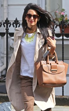Ring Finger Envy from Amal Clooney's Best Looks  Showing off her gorgeous sparkler (and a neon necklace!), Amal sets out for an afternoon in London.