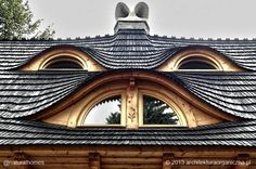 These eyebrow windows are on a traditional timber frame building in Poland by Polish architect Sebastian Piton. Eyebrow windows are complicated things to make but worth it on the right house. Find out more, including video, at www.naturalhomes.org/timeline/eyebrow-windows.htm