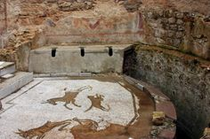 Ancient roman latrine with amazing mosaics. Villa Romana del Casale - a site which contains the richest, largest and most complex collection of Roman mosaics in the world. Sicily, 4th century, CE