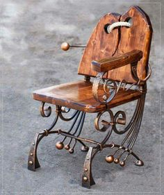 Interesting decorative metal and wood chair.