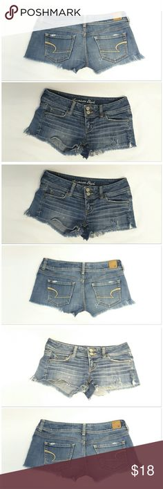 "AMERICAN EAGLE OUTFITTERS STRETCH Distressed AMERICAN EAGLE OUTFITTERS STRETCH, Distressed on purpose, Shorty cut off Denim Shorts, size 4 See Measurements, 2 exposed logo buttons on waistband above 2"" zipper closure, logo back right waistband, distressed on back pockets & hole by back right pocket, distressed right  front, left front hem split to bottom of pocket, stretchy, machine washable, 99% cotton, 1% spandex, approximate measurements: 16"" waist laying flat, 2"" inseam, 7"" rise…"