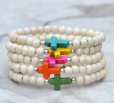 pulsera multiples cruces.
