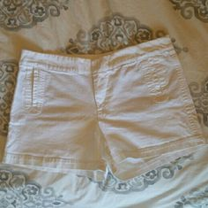 """Gap Shorts Super cute white Chino shirts from the Gap. 5"""" inseam. Good used condition. One small section with faded grass stains on back left near bottom hem, see first close up photo. Slight yellowing on bottom left front, see second close-up. Both sections might still wash out, hardly noticeable when worn. Offers welcome using the Offer button. No trades. GAP Shorts"""