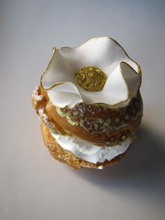 A Cream Puff by Connie Cupcakes of Toronto, via Paris Hotel Boutique.  Truly an eclair beyond compare! (photo only)