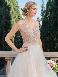 Shop the Casablanca Bridal 2315 Wedding Dress! In tulle with a beaded bodice, this sleeveless A-line gown features a V-neckline, V-back, and horsehair trim. Elegant Wedding Dress, Designer Wedding Dresses, Bridal Dresses, Wedding Gowns, Bridesmaid Dresses, Wedding Bells, Rembo Styling, Anna Kara, Casablanca Bridal Gowns