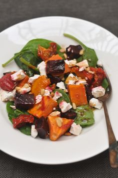 The Color Run Salad  1/2 butternut pumpkin 1 small sweet potato 2 beetroots 1 cup semi dried tomatoes 2 cups spinach or rocket leaves handful of pinenuts, toasted 100 grams feta cheese 1 teaspoon dried mixed herbs 3 tablespoons olive oil 1 tablespoon balsamic vinegar salt and pepper to taste
