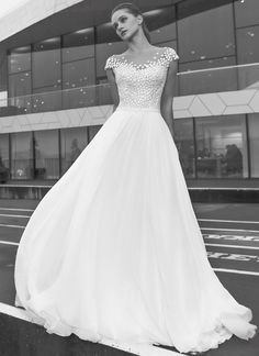 Bloom from Modeca wedding dresses 2018 - Off the shoulder, embroidered lace detialing. Natural waist line with chiffon skirt-- see the rest of the collection on www.onefabday.com