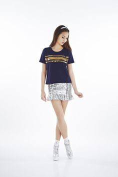 Sequin ribbon tee [1PPPS14001] It has a hotly emblazoned ribbon pattern in sequin to add a does of glamour to the tee. Pair it with a graphic skirt or matching sequin- then start counting your red packets ahead.