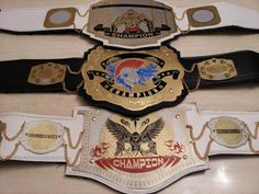 Belt Picture : Champions wearing our huge belts and lots of custom championship belt designs