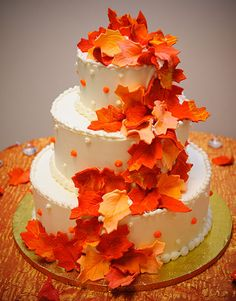 wedding ideas on a budget for fall | Fall Wedding Ideas on a Budget - Wedding Legend Love these bright autumn leaves mixed with cherry blossoms on a black matte tiered cake.