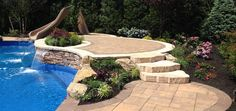 Do you love this raised pool patio as much as we do?! Above All Masonry installed this beautiful Cambridge pool patio.