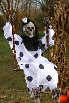 """Swinging Dead Clown 36""""this decoration includes a skeleton in a white and black polka dotted clown outfit with matching hat attached to a swing. Includes two hooks to hang swing from.Occasion: Hallowe"""