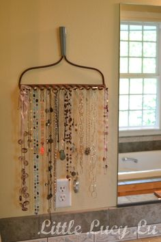 great idea to recycle an old rake head into a necklace organizer