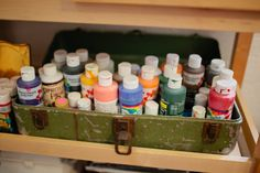 I have a thing for antique toolboxes. This one is perfect to corral some of our paints.