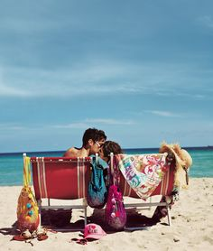 I'm craving this beach scene complete with comfy lounge, cute guy, cool thai purses, and a straw hat.