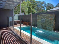 Indoor pool design using bluestone with glass balustrade & outdoor furniture setting - Pool photo 316350