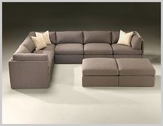 I found it!  Milo Baugham sectional sofa for Thayer Coggin!  It is still in production!